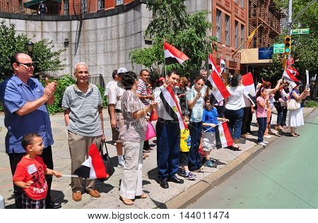 New York City - July 30, 2013: Egyptians demonstrating in Dag Hammerskjold Plaza across the street from the United Nations in support of the Army which deposed President Morsi's Islamic Brotherhood government