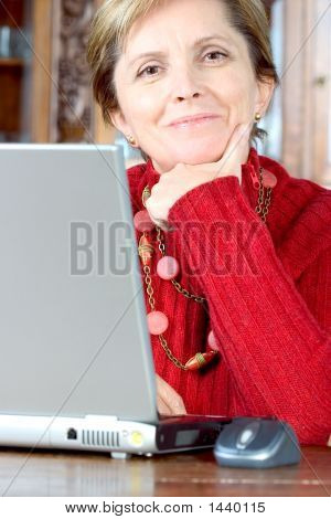 Middle-Aged Woman And Notebook