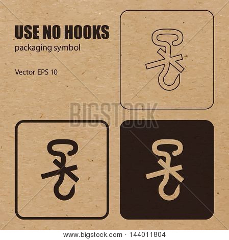 Use no Hooks vector packaging symbol on vector cardboard background. Handling mark on craft paper background. Can be used on a box or packaging. Vector EPS 10.