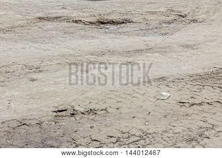 Pattern trace of huge road roller with spikes compacted soil at building site