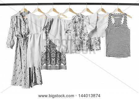 Set of white clothes on clothes racks isolated over white