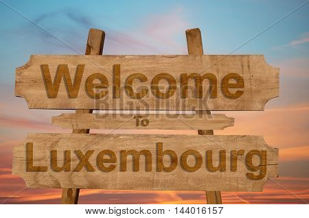 Welcome To Luxembourg Sign On Wood Background