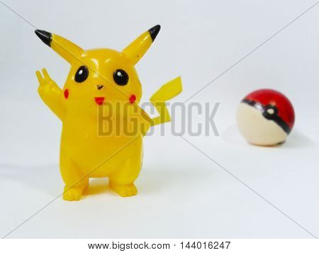 Nueva Esparta, Venezuela 21 august 2016. toy of caracter Pikachu from the anime pokemon with a pokeball back