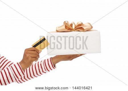 Hands holding gift box and credit card