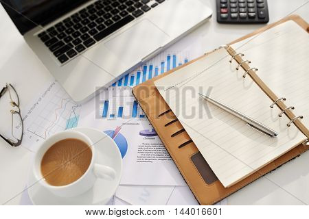 Belongings of business executive on table, view from above