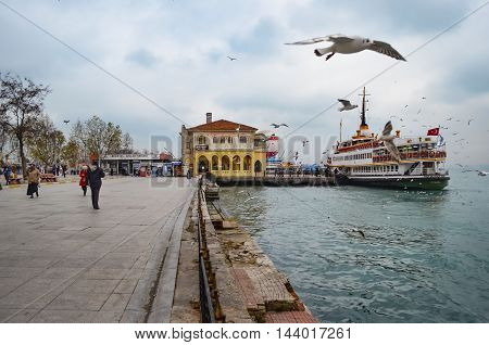 Istanbul Turkey - December 22 2012: Ferries in Istanbul Kadikoy pier and square. (called vapur in Turkish) continue to serve as a key public transport link for many Thousands of commuters tourists and vehicles per day. Seagulls are everywhere in Istanbul