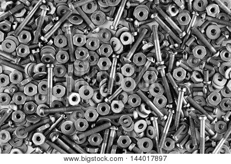 Black and white background of nuts and screws