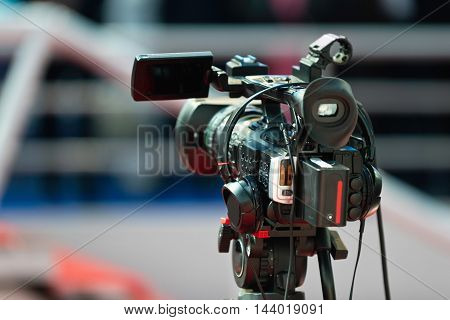 Video camera on a publicity event, toned image, close up, unrecognizable people