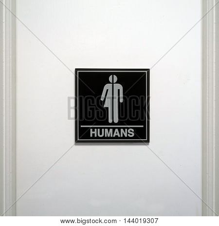 Gender neutral restroom sign that says,