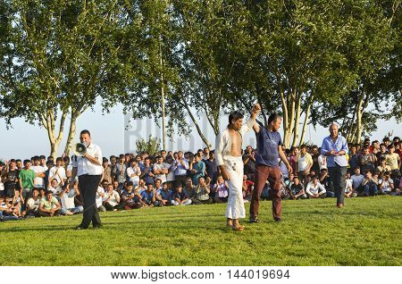 Istanbul Turkey - July 31 2016: Winners seen a wrestler declared. in Zeytinburnu district of Istanbul Turkmen wrestling sports events held in the coastal meadows. Turkmen Uzbek Afghan Turkish Turkmenistan Turkey and other Asian youth are competing in the