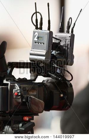Television camera covering an event, toned image, close up, unrecognizable people