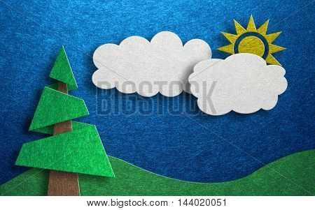 Three dimensional card design with one pine tree and a yellow sun hidden behind two clouds