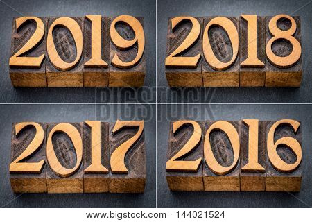 2016, 2017, 2018 and 2019 year set - text in letterpress wood type against gray slate stone