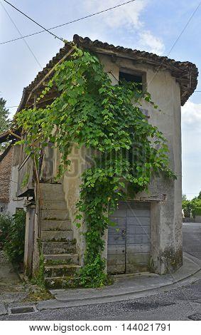 An old historic farm house in the small Italian village of Vernasso in Friuli Venezia Giulia north east Italy.