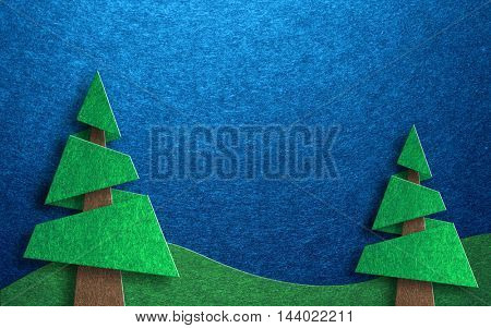 Seasonal greeting card design collage with two pine trees and rolling hills against a blue sky background