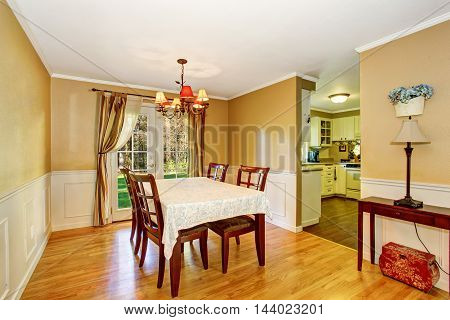 Dining Area With Table Set And Nice Curtains.