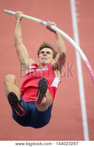 PRAGUE, CZECH REPUBLIC - MARCH 8, 2015: Adam Helcelet (#60 Czech Republic) competes in the men's pole vault event of the European Athletics Indoor Championship.