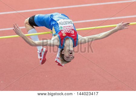 PRAGUE, CZECH REPUBLIC - MARCH 8, 2015: Aleksandr Shustov (#312 Russia) competes in the men's high jump event of the European Athletics Indoor Championship.