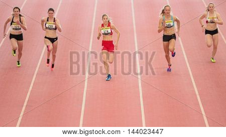 LINZ, AUSTRIA - FEBRUARY 21, 2015: Katharina Mahlfleisch (#374 Austria)  competes in the women's 60m event in an indoor track and field event.