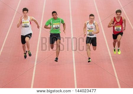 LINZ, AUSTRIA - FEBRUARY 21, 2015: Isaac Asare (#314 Austria) competes in the men's 60m event in an indoor track and field event.
