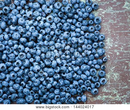 Close-up of fresh picked blueberries on wooden table