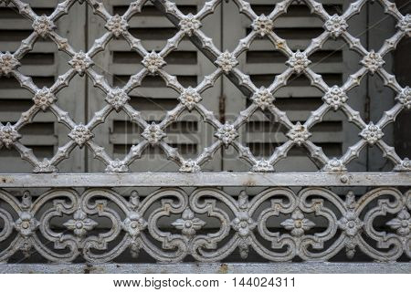 Fragment of ornamental wrought iron window grill in Toulouse, France.