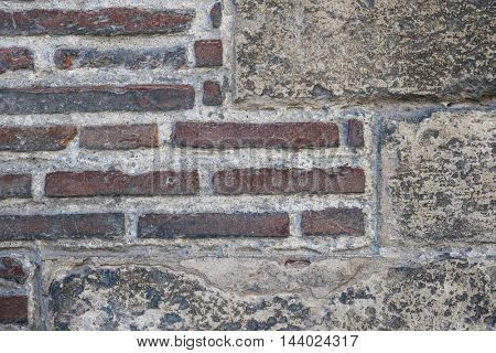Fragment of an old brick and stone wall. Saint Sernin Basilica, Toulouse, France.