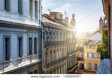 View from a window at old city street and buildings in Toulouse, France
