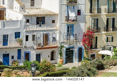 Ibiza Spain - June 3 2016: View of the Dalt Vila (Upper Town) of Eivissa (Ibiza Town) with its old buildings and hotel La Ventana on the street Carrer sa Carrossa under the cathedral