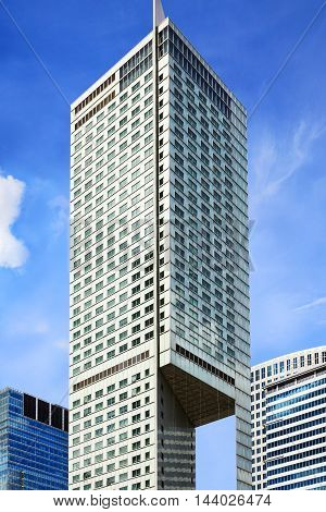 Skyscraper At Sunny Blue Sky