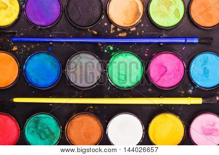 Palette Of Watercolor With Paintbrushes