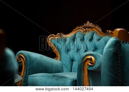 vintage luxury turquoise armchair isolated on black
