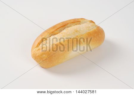 freshly baked mini baguette on white background