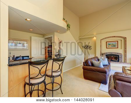 Great Half Living Room With View Of Home Bar And Stools
