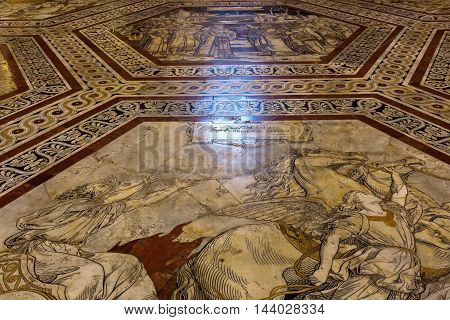 Siena Italy - July 07 2016: historic floor mosaic in the Siena Cathedral. The Siena Cathedral is today one of the most important examples of gothic architecture in Italy
