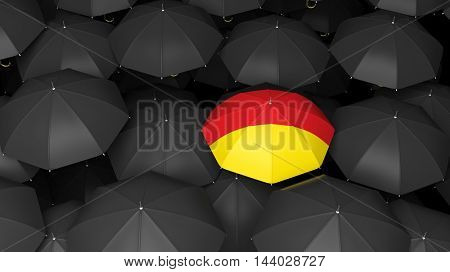 Top view of 3D rendering of German flag on umbrella over black background