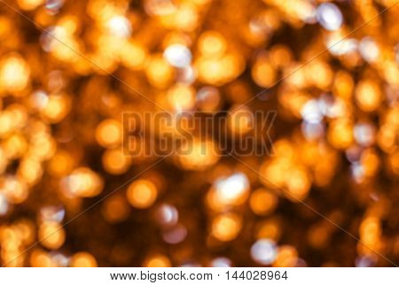 Holiday blurred bokeh golden color. Abstract background.