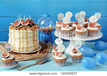 Candy-bar. Cupcakes and Cake on the blue background. Birthday party