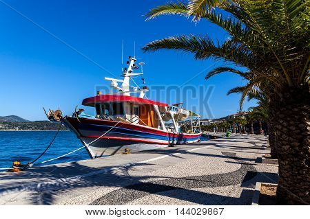 CEPHALONIA, GREECE 18.05.2016 Colorful Greek fishing boat in port of Argostoli