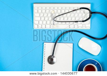 Medical report with pills and a stethoscope. medical concept.