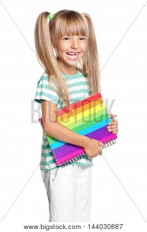 Cute little girl with books. Smiling child isolated on white background. Portrait happy kid. Back to school.