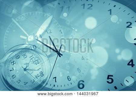 Clocks and abstract blue background