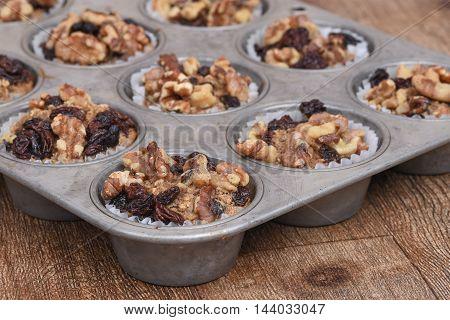 Walnut raisin muffins in an old fashion muffin pan