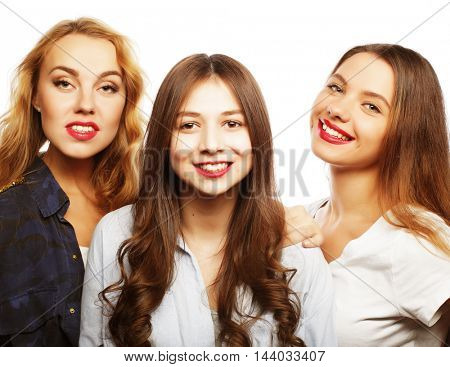Three stylish sexy hipster girls best friends.Standing together and having fun. Over gray background.