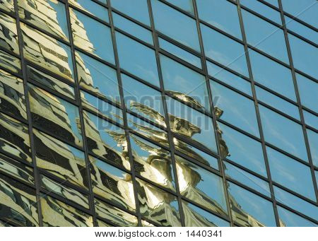 Chrysler Gargoyle Reflected In Hyatt Hotel In New York