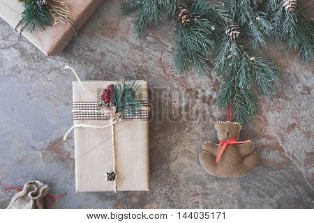 Christmas background with presents and teddy bear. Top view, vintage toned image, blank space.