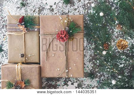 Christmas gifts wrapped with string. Top view, vintage toned image, blank space