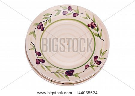 Four painted plates separated on white backboard