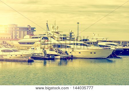 Many yachts in the port at sunset time.