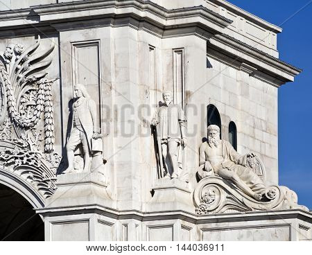 Detail of the statues of Marquis of Pombal and Nuno Alvares Pereira and the representation of the Douro River on the left of the the south façade of the Rua Augusta Arch in lisbon Portugal